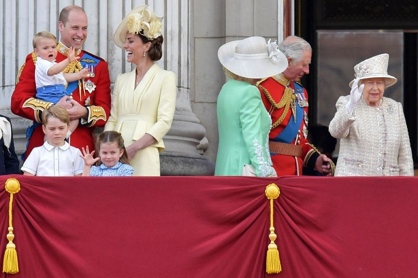 Prince William (far left) watches a Royal Air Force fly-past at Buckingham Palce in London with wife Catherine and his children, as well as Britain's Queen Elizabeth II (far right) Prince Charles and his wife Camilla.