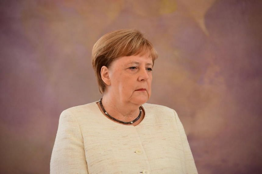 German leader Angela Merkel folded her arms visibly in a bid to stop the trembling.