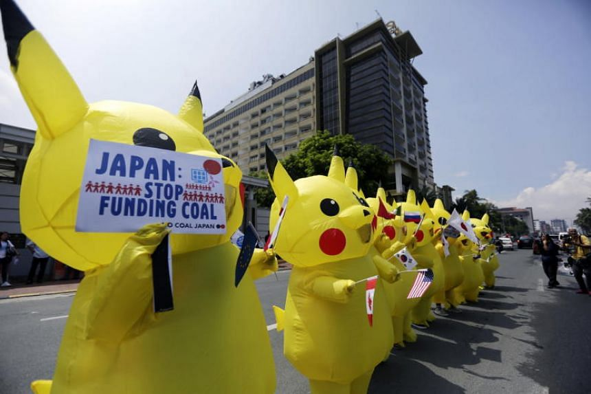 Climate activists protest in front of the Japanese embassy in Manila on June 25, 2019, to try to persuade Japan to stop funding coal as it prepares to host the G-20 leaders' summit.