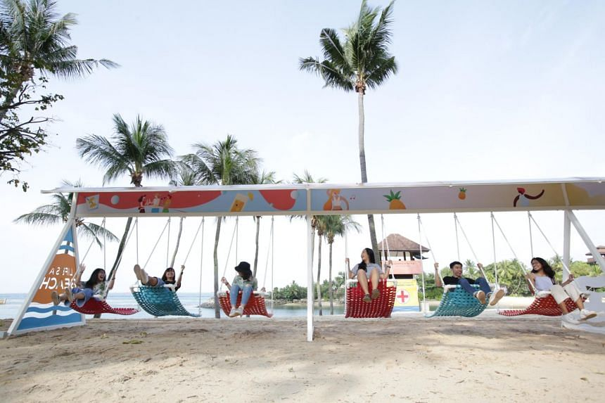 A 30m-long series of swings has been set up along Palawan Beach as part of the Make Time campaign to encourage locals to take breaks.