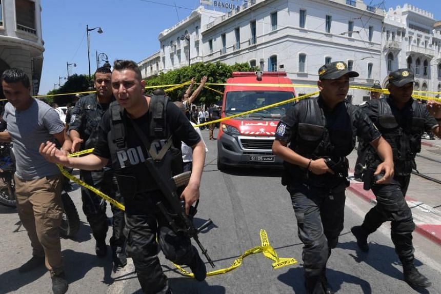 Tunisian security forces at the site of the attack after a suicide bomber blew himself up in central Tunis.