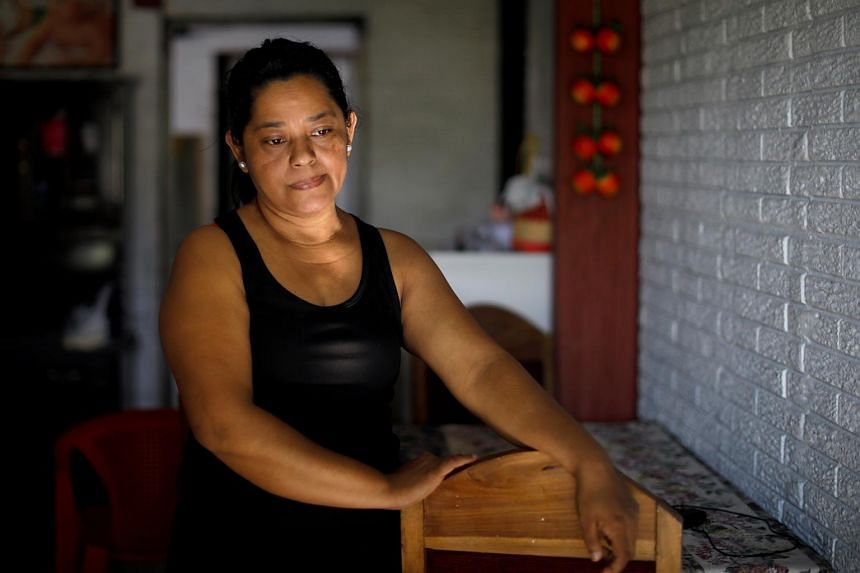 Ms Rosa Ramirez, the mother of a Salvadoran man who drowned with his daughter while trying to cross the Rio Grande river into the US, in her home in San Martin, El Salvador, on June 26, 2019.