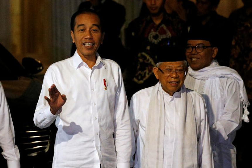 Indonesian incumbent President Joko Widodo and his running mate Ma'ruf Amin in Jakarta on June 27, 2019, ahead of the constitutional court verdict on the presidential election results.