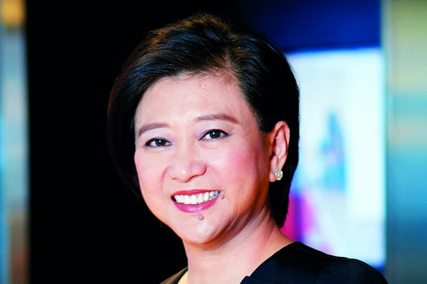 Singtel's CEO Chua Sock Koong saw her salary package nearly halved in the last financial year. Meanwhile, the telco's cyber-security business chalked up widening losses before interest and tax of $102 million for the 12 months to March 31. PHOTO: REU