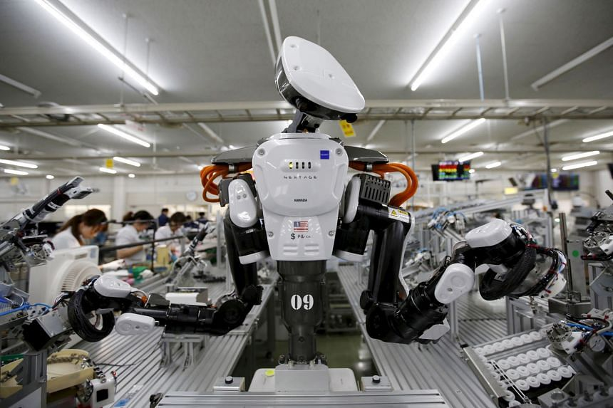A humanoid robot working side by side with employees at a factory in Japan. A report by UK-based research firm Oxford Economics says about one in three robots worldwide is in China, which accounts for around one-fifth of the world's total stock. But