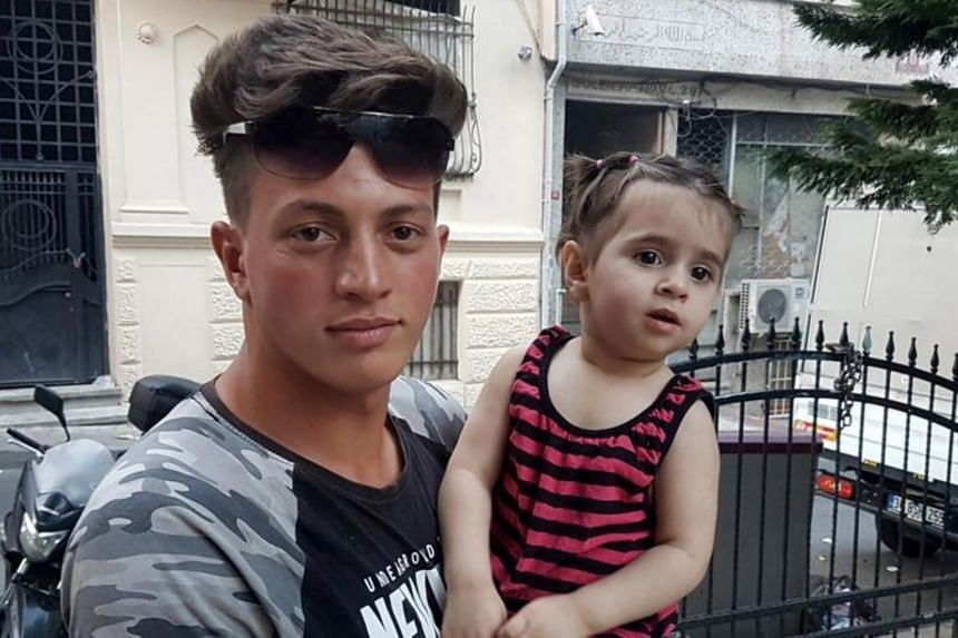 Mr Fawzi Zabaat (left) was walking in the working-class district of Fatih when he saw the two-year-old Syrian girl playing near the open window of her apartment.