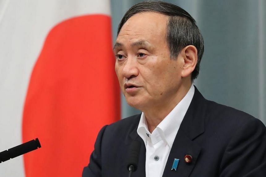Japan's chief government spokesman Yoshihide Suga cited clauses to show that the obligations under the security treaty are fair for both countries.