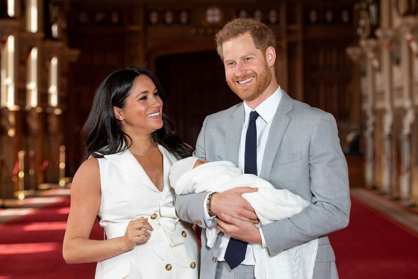 Harry and Meghan holding their baby son, Archie, at Windsor Castle.