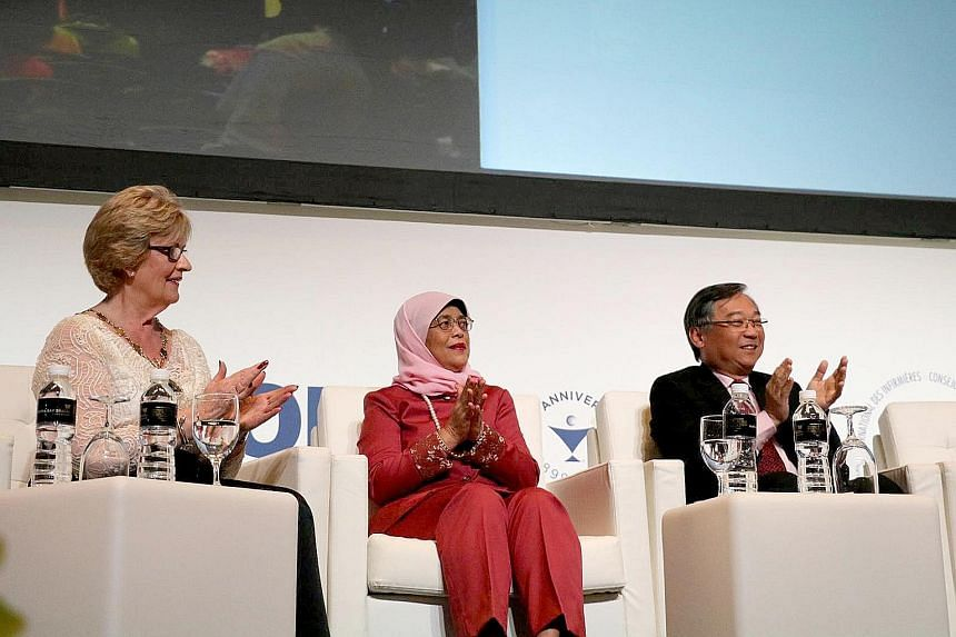President Halimah Yacob, flanked by International Council of Nurses president Annette Kennedy and Health Minister Gan Kim Yong, at the opening ceremony of the ICN congress at Sands Expo and Convention Centre yesterday. Over 5,000 nurses and nursing p