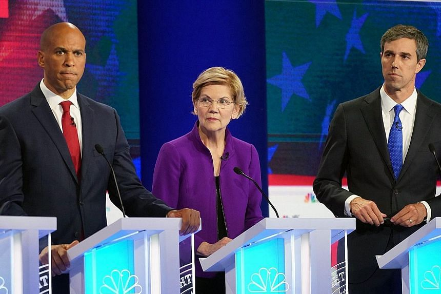 From left: Senators Cory Booker and Elizabeth Warren and former Texas congressman Beto O'Rourke taking part in the first Democratic presidential debate in Miami on Wednesday night.