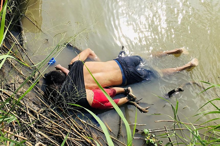 The bodies of Salvadoran migrant Oscar Alberto Martinez Ramirez and his nearly two-year-old daughter Valeria lying on the bank of the Rio Grande river in Matamoros, Mexico, on Monday after they drowned trying to cross the river to Brownsville, Texas.