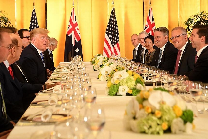 Environmental activists gathering in neighbouring Kobe city yesterday as world leaders arrived in Osaka for the G-20 Summit, to protest against Japan's support for new coal-fired power generation projects. US President Donald Trump meeting Australian