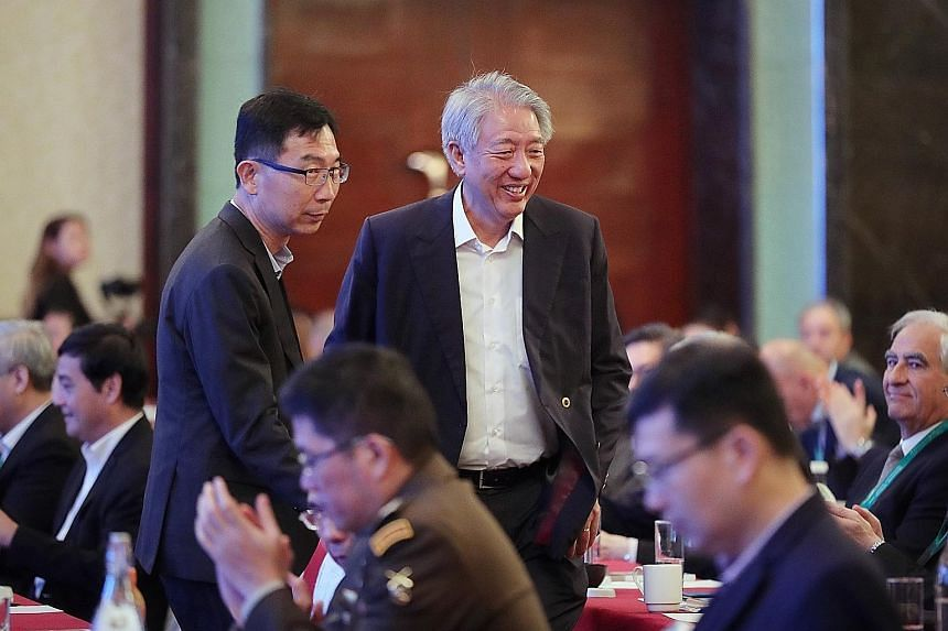 Senior Minister Teo Chee Hean, who is also Coordinating Minister for National Security, arriving at the second Singapore Defence Technology Summit at Shangri-La Hotel yesterday with the Defence Science and Technology Agency's chief executive Tan Peng