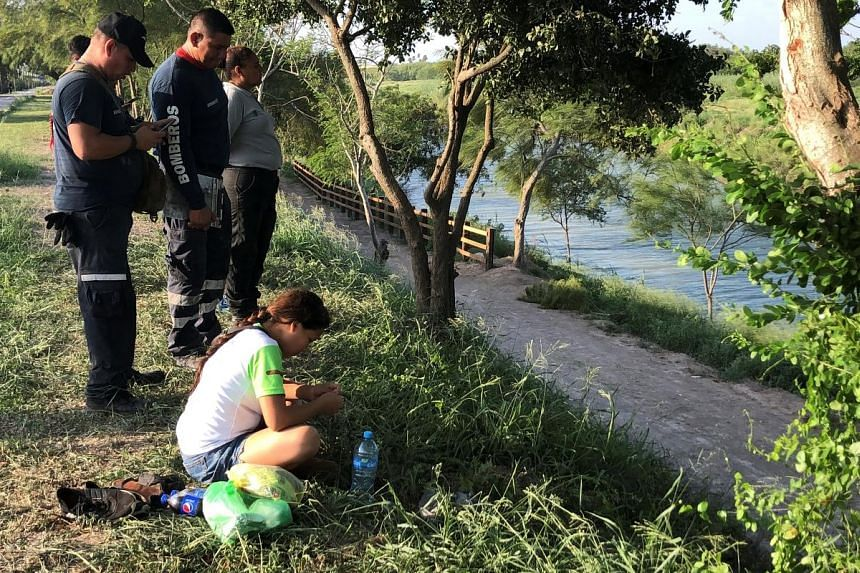 Salvadoran migrant Tania Vanessa Avalos with firefighters during a search for her husband Oscar Alberto Martinez Ramirez and daughter Valeria.
