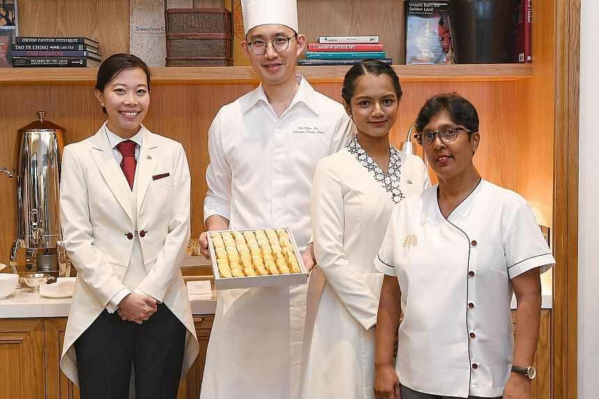 (From left) Raffles Hotel head butler Grace Kiong, executive pastry chef Tai Chien Lin, junior lobby ambassador Shobana S. Muthiah and senior housekeeping supervisor Vaithilingam Krishnaveny stand to benefit from the new initiatives - one of which is
