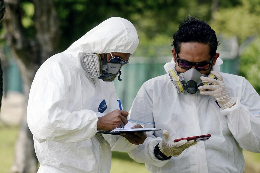 Emergency personnel checking the air quality in Pasir Gudang, on June 25, 2019, after toxic fumes were reported in the area.