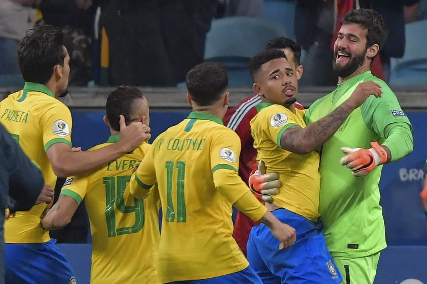 Brazil's Gabriel Jesus (second from right) celebrating after scoring his penalty to defeat Paraguay in Porto Alegre, Brazil, on June 27, 2019.