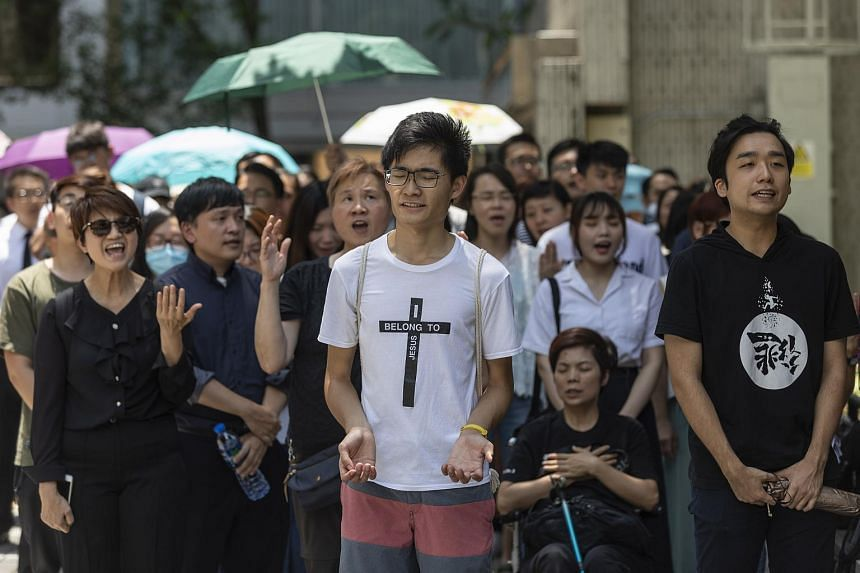 Christian worshippers singing hymns to voice their opposition to an extradition law in Hong Kong, on June 14, 2019.