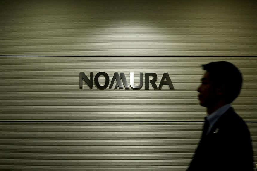 Nomura confirmed the arrest of former workers but declined to offer details, saying an investigation is under way.