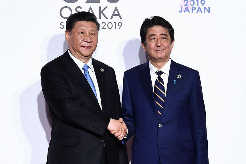 Talks between Chinese President Xi Jinping (left) and Japanese Prime Minister Shinzo Abe were reportedly cordial and frank.