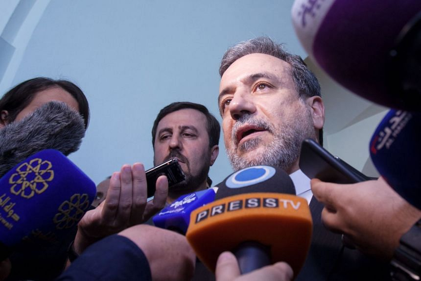 Abbas Araghchi talks to the press at the end of the meeting.