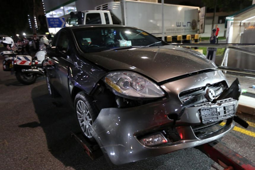 The front bumper of the vehicle was damaged and debris from the car was seen on the pavement outside the supermarket.
