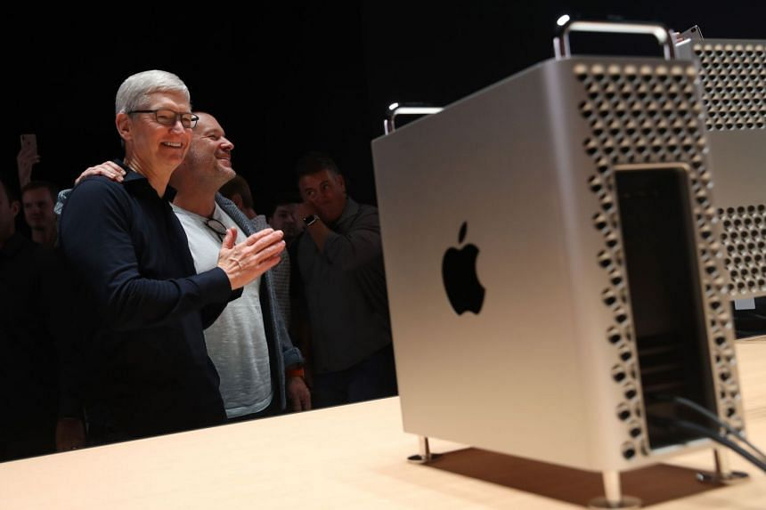 Apple CEO Tim Cook (left) and Apple chief design officer Jony Ive look at the new Mac Pro during the 2019 Apple Worldwide Developer Conference.