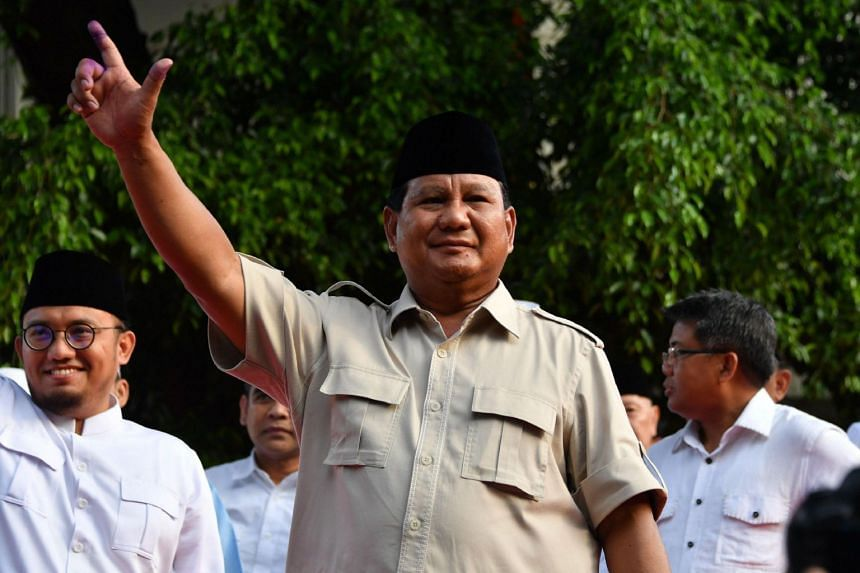 Indonesian presidential candidate Prabowo Subianto gestures after a press conference during the general election in Jakarta on April 17, 2019.