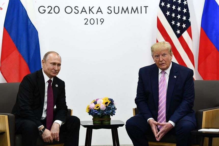 """""""Don't meddle in the election, please,"""" US President Donald Trump (right) said to Russian President Vladimir Putin at the Group of 20 summit."""