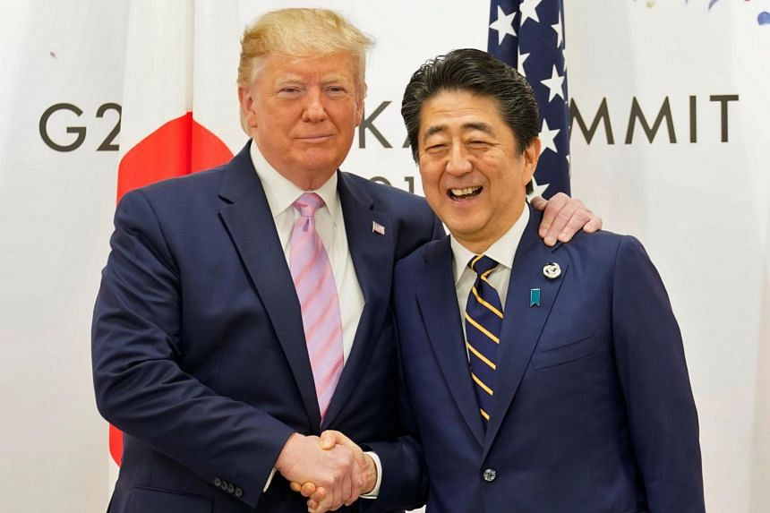 US President Donald Trump shakes hands with Japan's Prime Minister Shinzo Abe during the G-20 leaders summit in Osaka, Japan, on June 28, 2019.