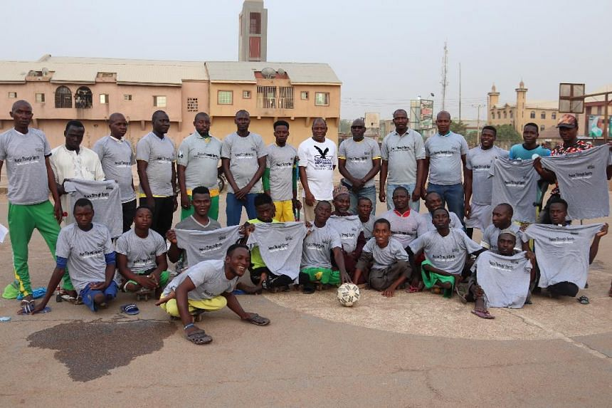 A football team created thanks to the Peace Through Sports initiative, a project in which young people in conflict areas of northern Nigeria can use sports as a platform for peacebuilding while learning skills to help them secure employment. PHOTO: T