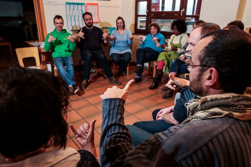 The whole staff of the Bouillon youth hostel has taken sign language lessons. PHOTO: PIERRE-YVES THIENPONT