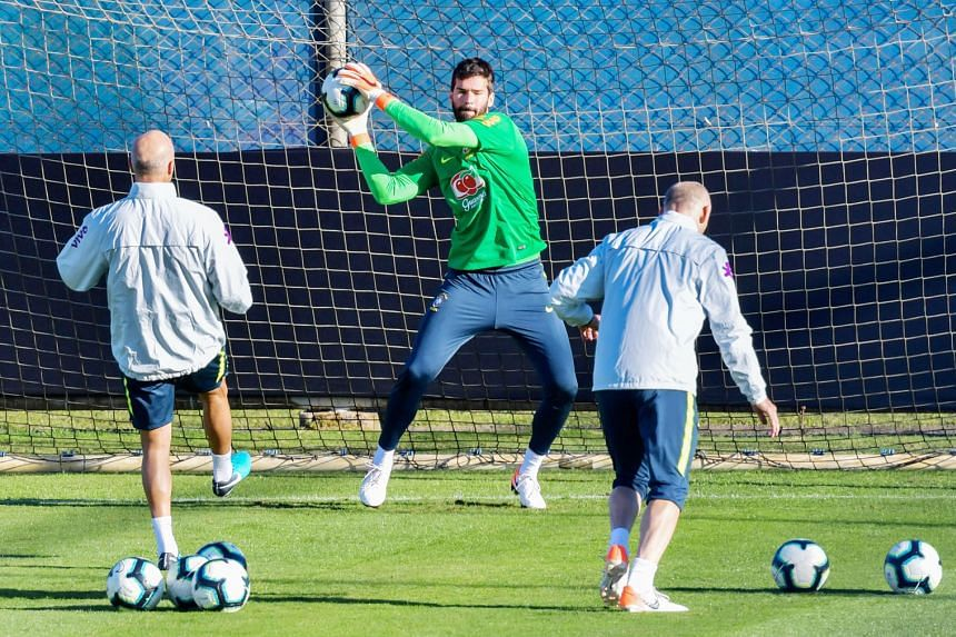 Brazil goalkeeper Alisson practising penalty saves during a training session in Porto Alegre on Wednesday. The Brazilians are keen to avoid a third loss on penalties to Paraguay when they meet in the quarter-finals of the Copa America. PHOTO: AGENCE