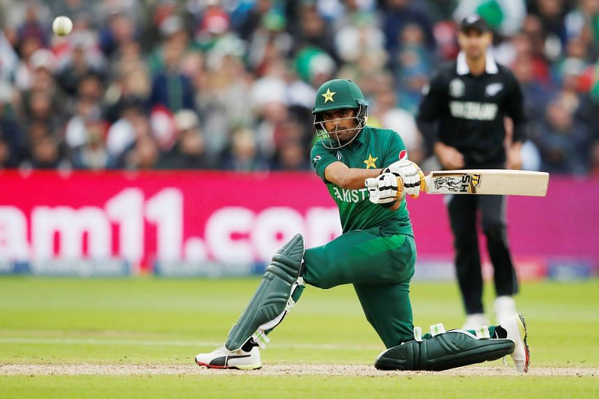 Pakistan's Babar Azam hitting a four at Edgbaston, Birmingham on Wednesday. His 101 not out was instrumental in the team chasing down New Zealand with five balls remaining. PHOTO: REUTERS