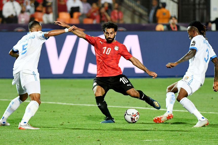 Mohamed Salah scoring his first goal of the Africa Cup of Nations, as hosts Egypt secured a place in the last 16 on Wednesday with a 2-0 Group A win over the Democratic Republic of Congo. Ahmed Elmohamady prodded Egypt ahead on 25 minutes after a wic
