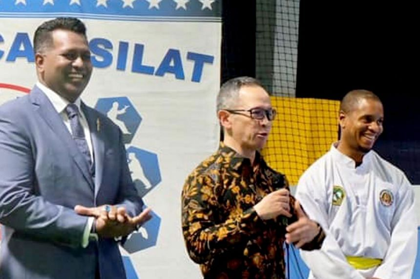 Indonesian Ambassador to the US, Mahendra Siregar, is flanked by Persisi CEO Sheik Alau'ddin and US Pencak Silat Federation vice-president Abdul Malik Ahmad at the US Open pencak silat championships last weekend. The Singapore team returned with 16 o