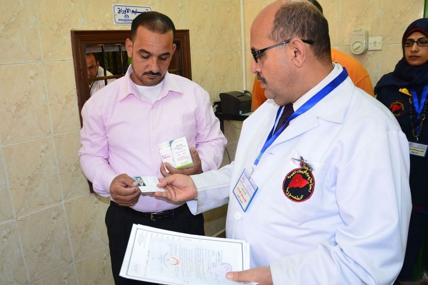 Ali Fawzi (left) is the first Egyptian citizen to have used the medicine Sovaldi to overcome Hepatitis C. PHOTO: SAYED ELBAZ, ALMASRY ALYOUM