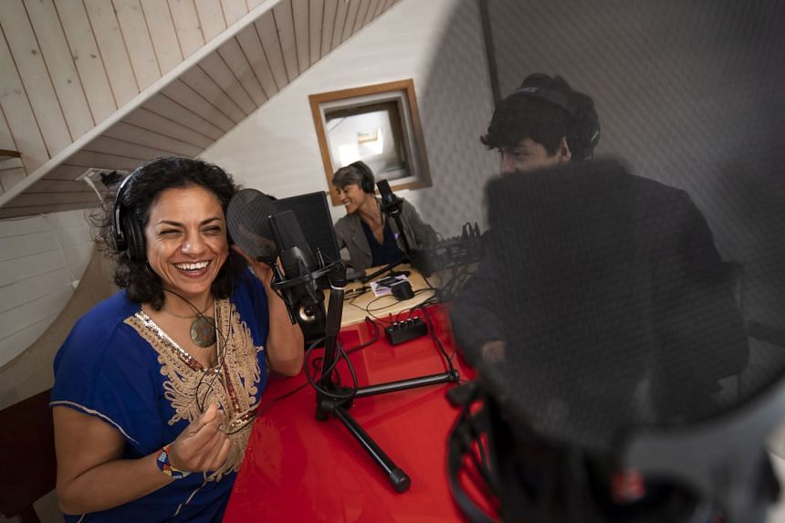 The hosts of Radio Chiara are migrants who go on air to share their culture, music, personal stories and experience. PHOTO: TI-PRESS/PABLO GIANINAZZI