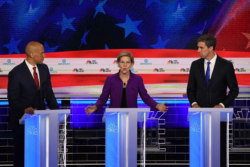 (From left) Cory Booker, Elizabeth Warren and Beto O'Rourke take part in the debate.