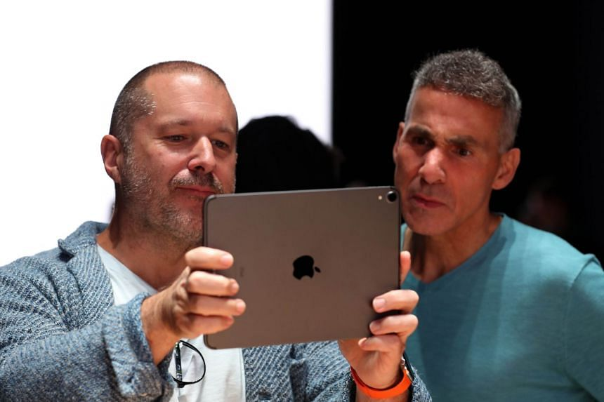 Jony Ive (left) uses an iPad to have an augmented reality view of the frame of the new Mac Pro as Apple senior vice-president of hardware engineering Dan Riccio looks on during the 2019 Apple Worldwide Developer Conference in San Jose, California.