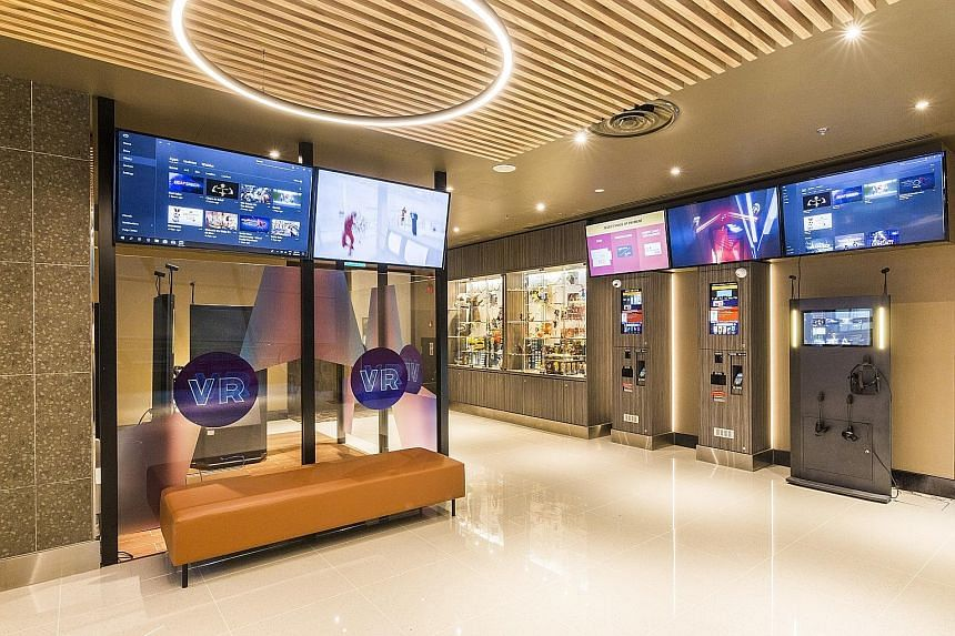 Virtual reality pods in the foyer of GV Funan allow patrons to enjoy immersive VR gaming and cinematic content.