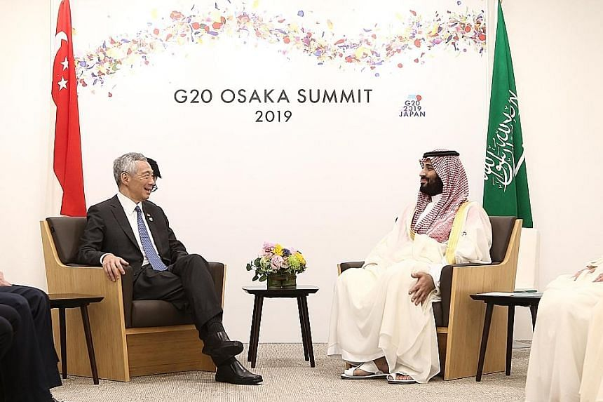 Prime Minister Lee Hsien Loong meeting Saudi Arabia's Crown Prince Mohammad Bin Salman yesterday on the sidelines of the Group of 20 Leaders' Summit in Osaka. PM Lee expressed hope that more Singaporeans will be allowed to perform the annual haj pilg