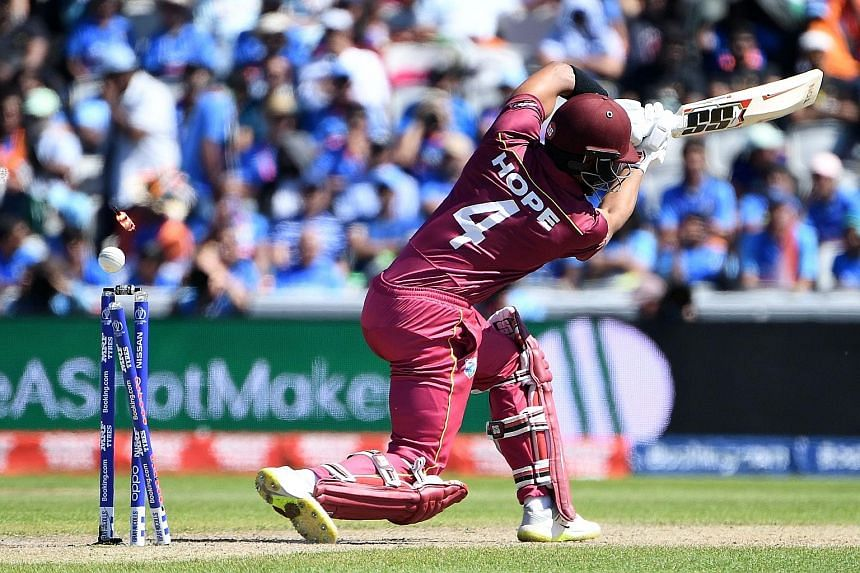 The West Indies' Shai Hope is bowled by India's Mohammed Shami for just five runs during their group-stage match at Old Trafford in Manchester on Thursday.