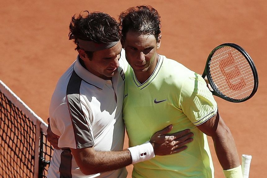 Swiss legend Roger Federer congratulating Spanish clay king Rafael Nadal after he lost their French Open semi-final on June 7. The pair are tipped to meet in the final four in a fortnight at Wimbledon.