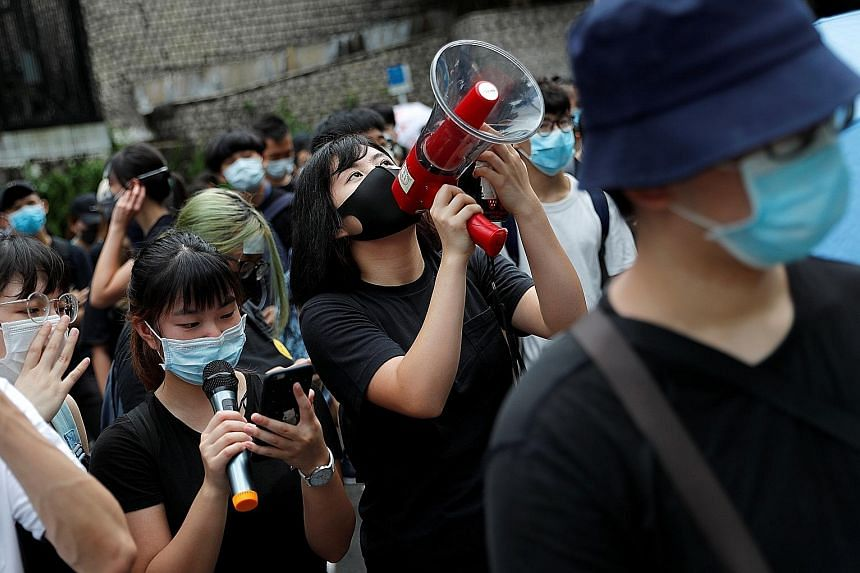 Protesters outside the Department of Justice building during a rally against the extradition Bill in Hong Kong on Thursday. PHOTO: REUTERS