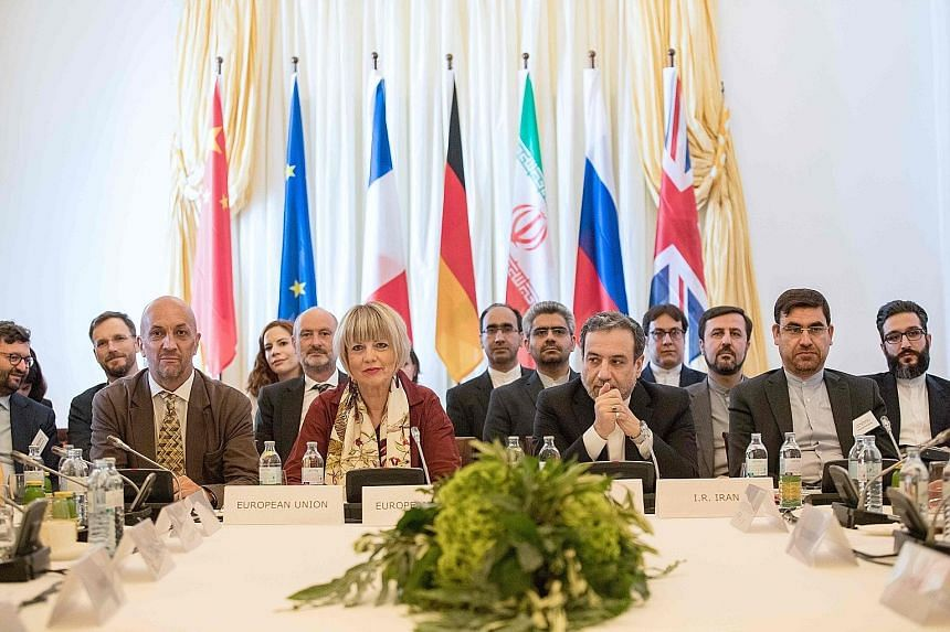 Diplomats at yesterday's meeting on the Iran nuclear deal in Vienna included Mr Abbas Araghchi (second from right), Iran's Deputy Foreign Minister, and Ms Helga Schmid, secretary-general of the EU's External Action Service. PHOTO: AGENCE FRANCE-PRESS