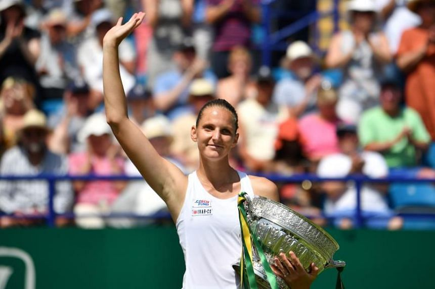 Czech Republic's Karolina Pliskov cruised to her second Eastbourne International title with a 6-1, 6-4 destruction of Germany's Angelique Kerber.