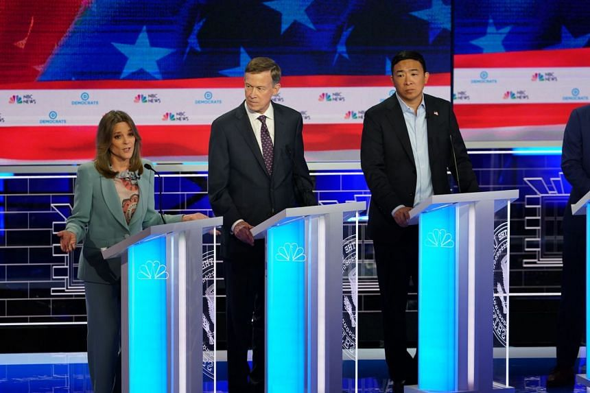 Marianne Williamson speaks as former governor John Hickenlooper of Colorado and Andrew Yang look on during the Democratic presidential debate in Miami.