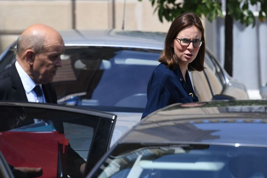 Amelie de Montchalin (right) leaves the Elysee palace after a weekly Cabinet meeting.