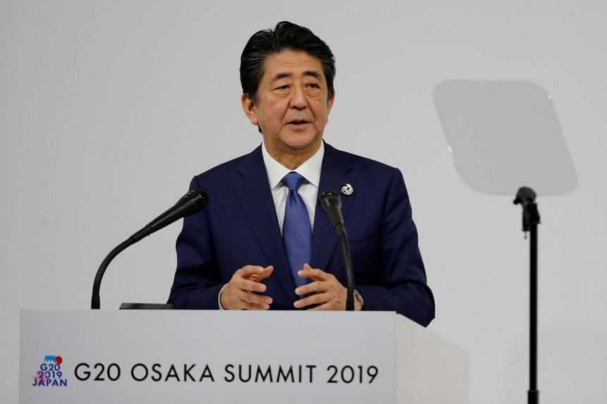 """The global economy continues to face downside risks as trade tensions persist,"" said Japanese Prime Minister Shinzo Abe."